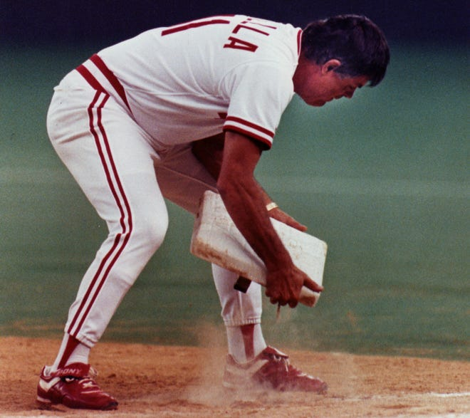 AUGUST 21, 1990: Reds Manager Lou Piniella threw first base into right field while disputing Barry Larkin being out at first base during a double play in the 6th inning. He launched first base after being ejected from the game.