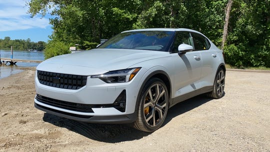 The 2021 Polestar 2 electric car has a long hood and roofline, 4.45-second 0-60 mph acceleration and responsive handling.