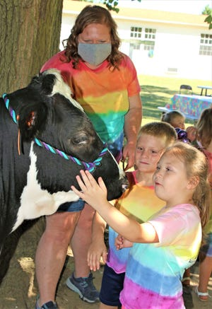 Children from Rainbow Magic Daycare in Green Springs got the chance to meet and pet some farm animals that were on their way to the Sandusky County Fair on Thursday morning.