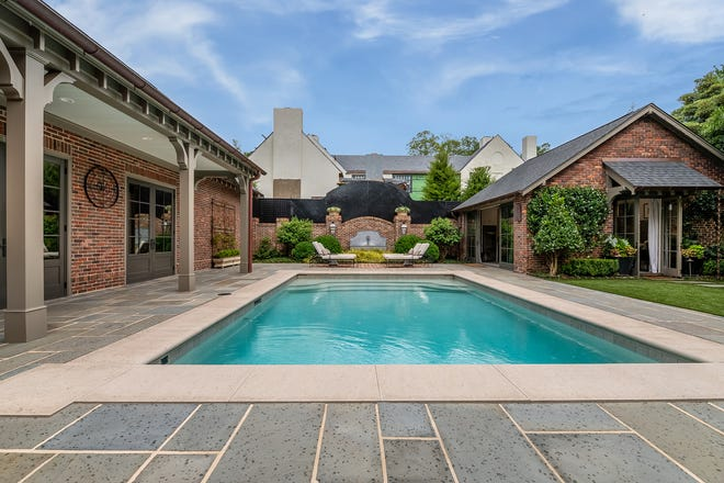 A pool house renovated from a 1920s garage.