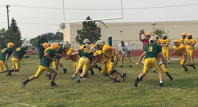 C.M. Russell head football coach Dennis Morris, presiding over a practice earlier this summer, is waxing optimistic over the Rustlers and their chances in the 2020 Eastern AA season, which starts Friday at Memorial Stadium against Belgrade.