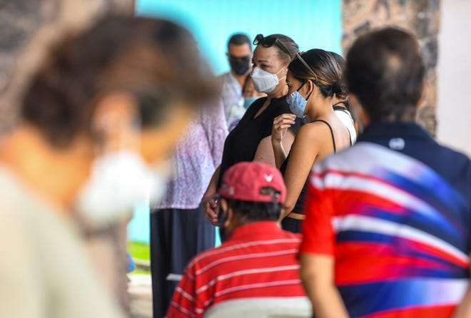 Housing occupants and others wait to be processed for COVID-19 testing at the Guma Trankilidat elderly housing facility in Tumon in this Aug. 20 file photo.