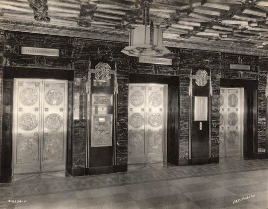A historic photo shows the elevators in the lobby of the Circle Tower in 1930.