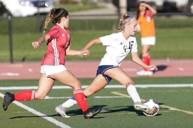 Central Catholic's McKenna Lutz (12) dribbles against Lafayette Jeff's Citlali Alavez-Hernandez (8) during the first half of an IHSAA girls soccer game, Wednesday, Aug. 19, 2020 in Lafayette.