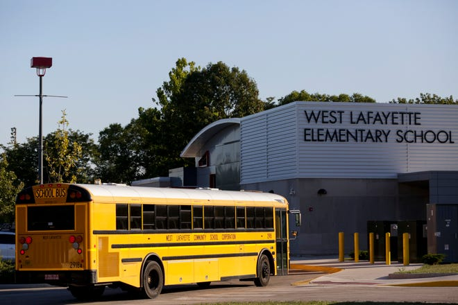 A bus lines up outside West Lafayette Elementary School to drop off students for the first day of classes, Thursday, Aug. 20, 2020 in West Lafayette.