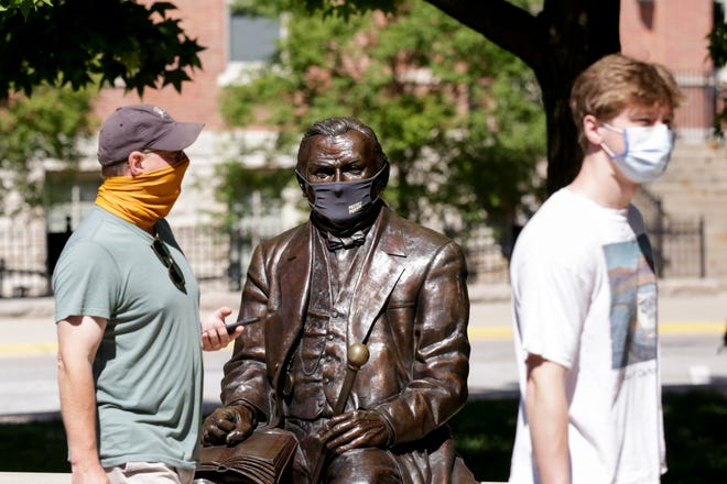 "A statue of John Purdue, the founder of Purdue University, is seen wearing a ""Protect Purdue"" mask, Thursday, Aug. 20, 2020 in West Lafayette."