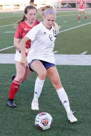 Central Catholic's Caroline Lutz (19) dribbles the ball against Lafayette Jeff's Madison Cacucciolo (17) during the first half of an IHSAA girls soccer game, Wednesday, Aug. 19, 2020 in Lafayette.
