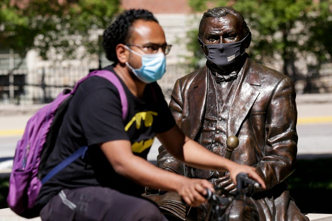"""A statue of John Purdue, the founder of Purdue University, is seen wearing a """"Protect Purdue"""" mask, Thursday, Aug. 20, 2020 in West Lafayette."""