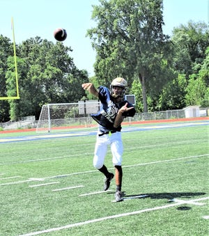 Lancaster quarterback senior quarterback Titan Johnson throws a pass during practice at Fulton field. The Golden Gales open the season at New Albany on Aug. 28.