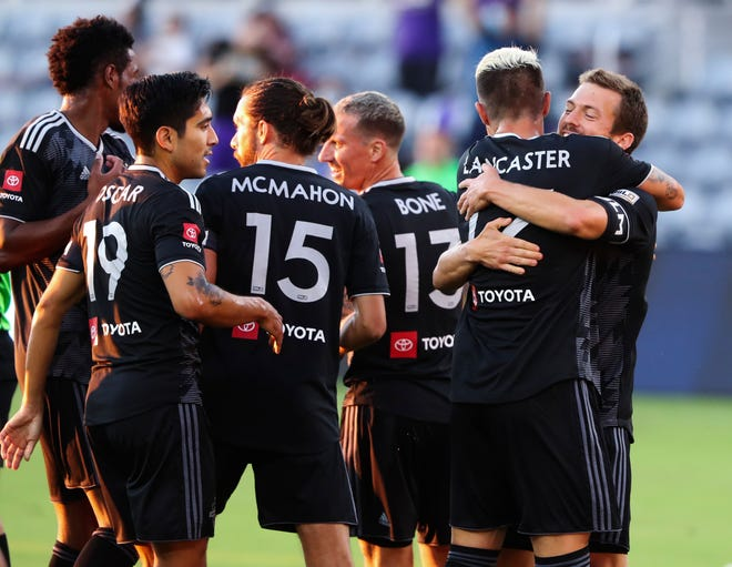 Louisville City FC's Cameron Lancaster (17), second from right, celebrated with teammate Antoine Hoppenot (29) after scoring their first goal against Sporting Kansas City II during their match at Lynn Family Stadium on Aug. 19, 2020.