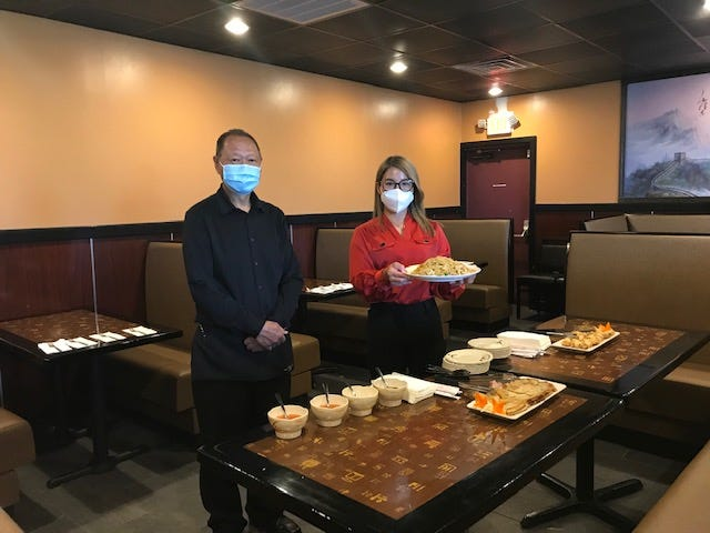 K.C. Chan, manager, and Rachel Chen, the co-owner of Home Asian Bistro, 2067 W. Fourth St. celebrated a ribbon cutting with the Richland Area Chamber of Commerce and Economic Development Thursday at the new restaurant. Rachel and her husband Paul Xiao also own and operate Wokano's on West Fourth Street. Here, food was prepared for guests at the ribbon cutting. Lou Whitmire/News Journal