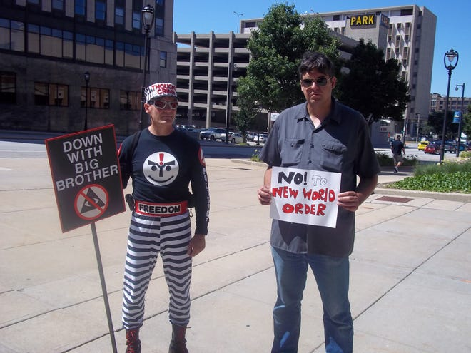 Richard McCaslin, left, as Thoughtcrime, and Tea Krulos demonstrate in downtown Milwaukee in 2011.