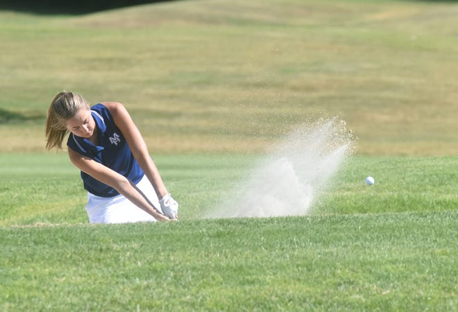 Mountain Home's Reagan Hasselwander hits a shot out of the sand on Hole 3 on Wednesday at Big Creek Golf & Country Club.