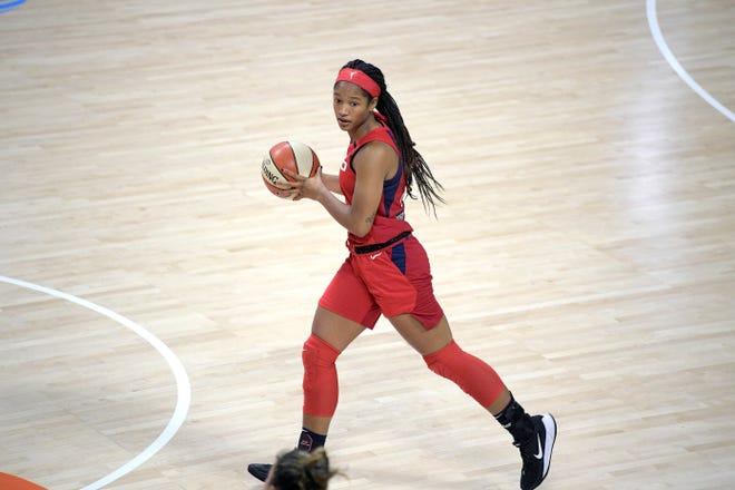 Washington Mystics guard Stella Johnson brings the ball up the court during the second half of a WNBA basketball game against the Las Vegas Aces, Saturday, Aug. 15, 2020, in Bradenton, Fla. (AP Photo/Phelan M. Ebenhack)
