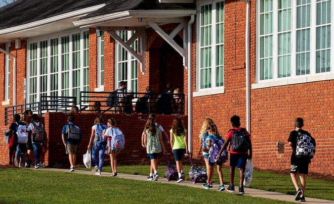 Students arrive for classes on the first day of school at the Pike Road Middle School in Pike Road, Ala., on Thursday morning August 20, 2020.
