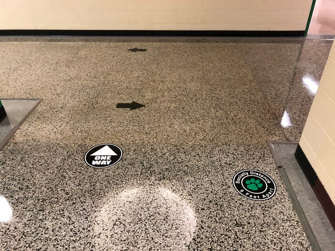One-way hallway signs at Yorktown Community Schools are meant to keep students facing the same direction between classes.