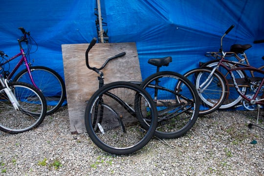 Bikes needing repairs and adjustment sit on the lot at Bikes For Tykes, Wednesday, Aug. 19, 2020, in North Naples.