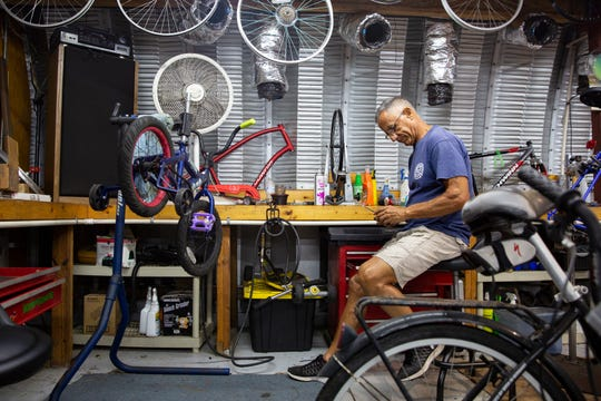Bikes For Tykes volunteer Nick Marino works on a bike, Wednesday, Aug. 19, 2020, at the Bikes For Tykes workshop in North Naples.