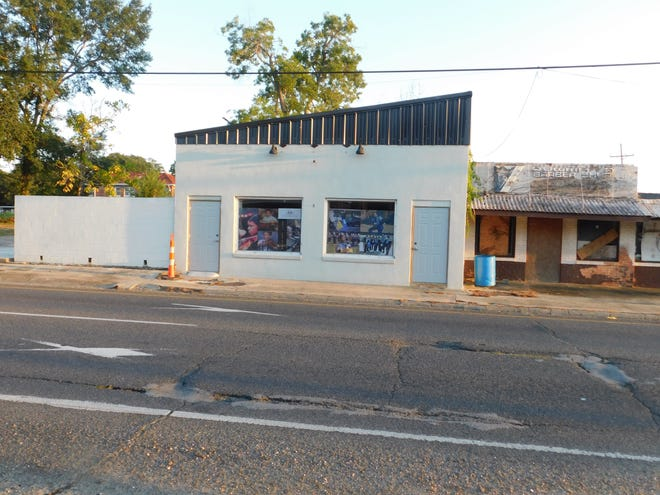 The former barbershop and other buildings in Opelousas now unused and boarded up next to a newly renovated Bottoms Up building, nestle in to the corner of Landry and Railroad streets.