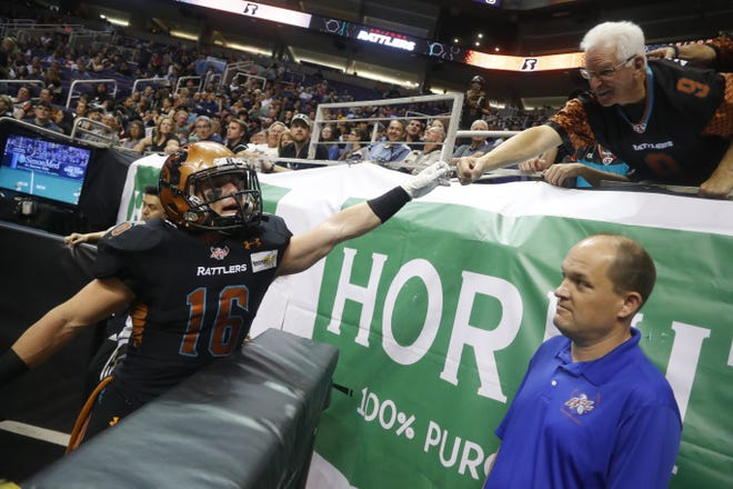 Rattlers' Jarrod Harrington (16) fist bumps a fan during the second half against the Sugar Skulls at Talking Stick Resort Arena in Phoenix on March 16, 2019.