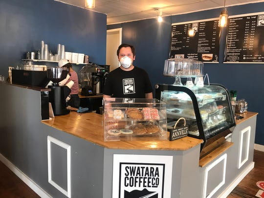 Owner John Noll stands behind the counter at Swatara Coffee Co.'s new location in Annville. Despite the COVID-19 pandemic, the Annville location opening has gone well, Noll said.