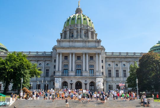 "Hundreds of students and parents from around the state stand on the steps of the Pennsylvania State Capitol Complex in Harrisburg for the ""Let our Kids Play in PA"" rally, Thursday, August 20, 2020. They are showing their support in favor of having fall sports this year."