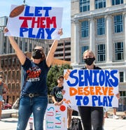 """Hundreds of students and parents from around the state stand on the steps of the Pennsylvania State Capitol Complex in Harrisburg for the """"Let our Kids Play in PA"""" rally, Thursday, August 20, 2020. They are showing their support in favor of having fall sports this year."""
