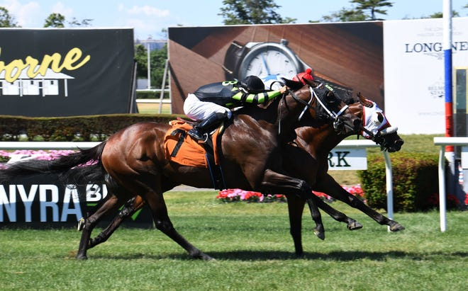 Reylu Gutierrez, on the inside, guides Mad Munnys to the victory by a head at a June 21 race at Belmont Park. The race was the day after he mounted up for his first Triple Crown race, the Belmont Stakes. (Photo: Coglianese Photos)