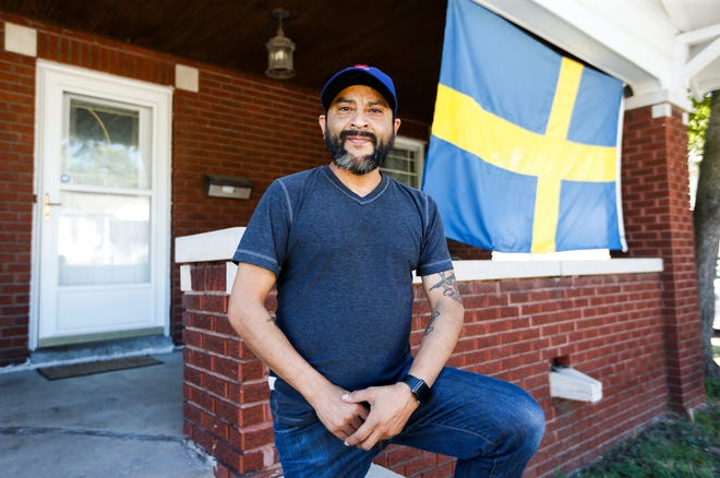 Raymond Rios flies the flag of Sweden on his front porch on North National Avenue. It is a gift from his in-laws in Strömsund, Sweden.