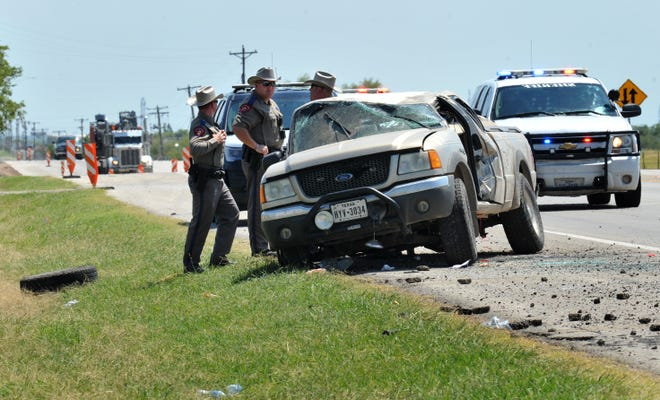 Texas DPS Troopers and Wichita County Deputies work the scene of a rollover pin-in accident Thursday afternoon on U.S 281, south of Wichita Falls.