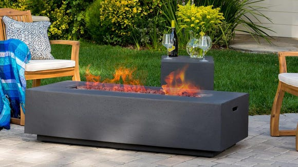 This gas fire pit is a stately addition to any backyard area.