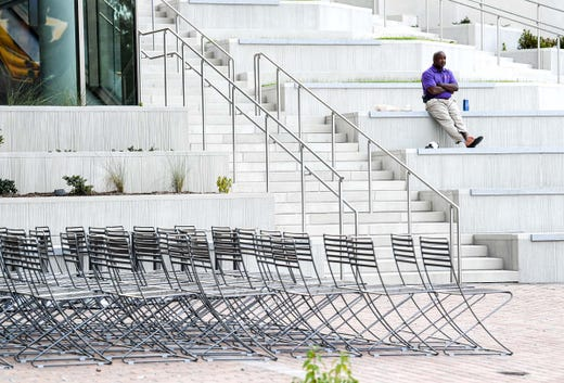 Custodian Gary Whitner takes a break from cleaning inside the new College of Business during the first day of fall classes at Clemson University in Clemson Wednesday, August 19, 2020.