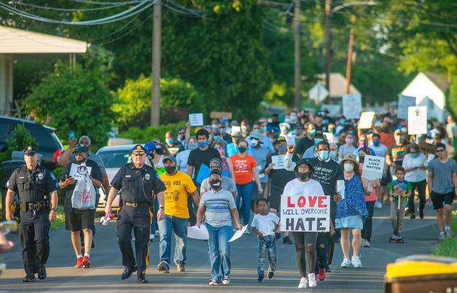 File - Bensalem police joined a march against racism in June hosted by the Bucks County branch of the NAACP. On Wednesday, the two agencies will announce what they say is a first-of-its-kind partnership. [WILLIAM THOMAS CAIN / PHOTOJOURNALIST]