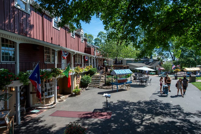 Visitors strolling by the shops at Peddler's Village, in Lahaska, on Thursday, Aug. 20, 2020.