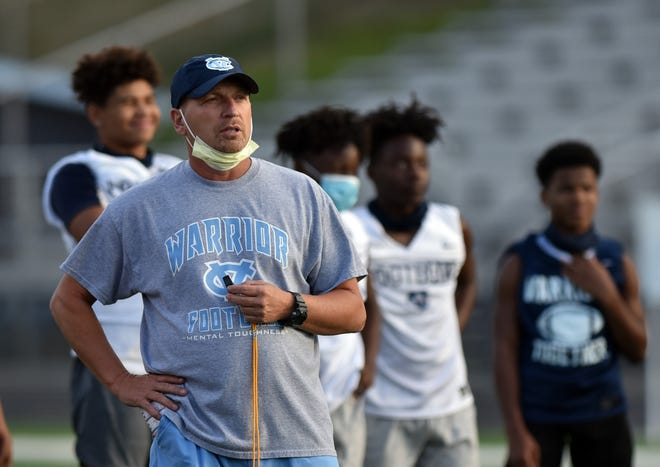 Central Valley High School head football coach Mark Lyons watches practice.