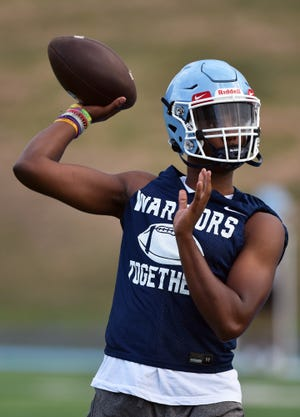Central Valley High School quarterback Ameer Dudley warms up his arm during practice.