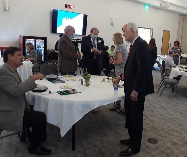 State economist Loren Scott (at right) talks to attendees Thursday during his presentation Thursday at Thibodaux Regional Medical Center.