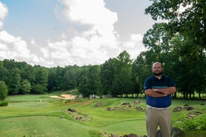 General Manager Trip Marion poses on Tot Hill No. 3 that was named as one of the best 18 holes since 2000 by Golf Digest on August 10.