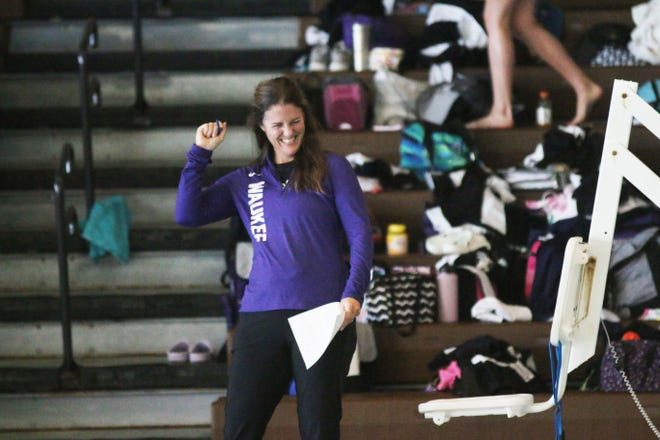Waukee head girls swimming coach Shelley Twigg laughs during a practice last season.