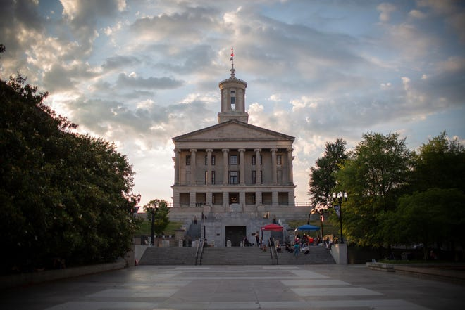 A small group of demonstrators camp out across from Tennessee State Capitol on the War Memorial Plaza in Nashville, Tenn., on Sunday, June, 14, 2020.