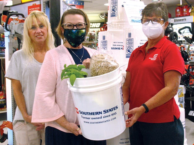 Bobbi Jo Chandler, left, and Becky Bastianelli, right, both with Southern States, welcome Kent-Sussex Industries Inc. Director of Community Relations Alicia Hollis as she supports their fundraising efforts for KSI.