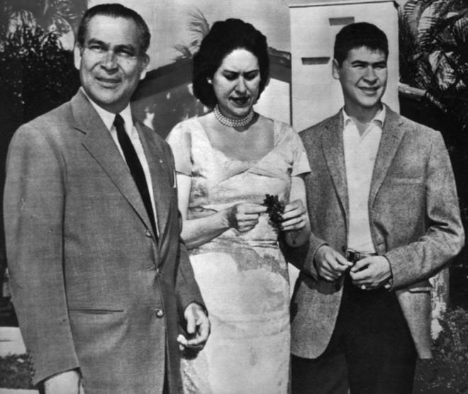 (NY16-April 7) BATISTA, THE FAMILY MAN - Cuban President Fulgencio Batista, left, stands in sunshine with his wife, Marta Fernandez and son, Jorge, 15, before their private chapel at Batista's country home near Havana yesterday. (hlv/b21400HLV) 1958.