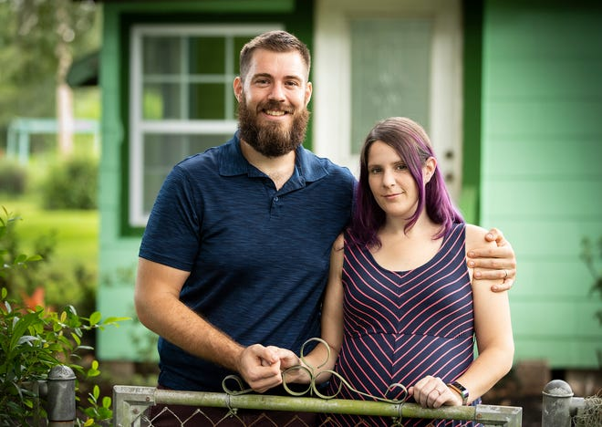 Richard Littleton and his wife, Jennifer, at their home in Lakeland on Friday. Littleton cited his  wife's pregnancy as part of the reason he quit his teaching job with Polk County Public Schools rather than return to the classroom during the COVID-19 pandemic.