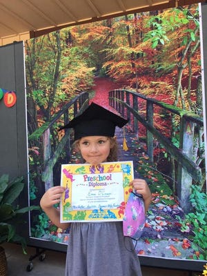 New Dunsmuir Elementary School kindergartener Emme O'Connor crosses the bridge from Preschool to grammar school during her back to school parent conference.