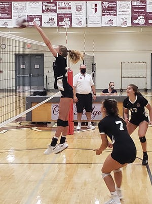 Lady Wildcat Senior Brenna Allred goes up for a block against Campbell County.
