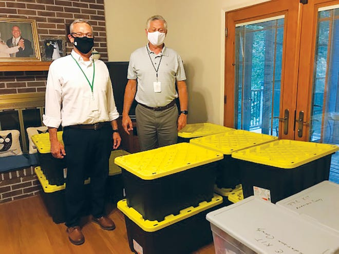 Anderson County Schools Director Tim Parrott, right, and Director of Career and Technical Education Kelly Meyers pick up boxes of personal protective equipment (PPE), from the Rotary Club of Oak Ridge.