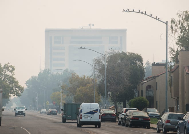 The San Joaquin County courthouse in downtown Stockton is obscured by smoke from area wildfires on Aug. 20.