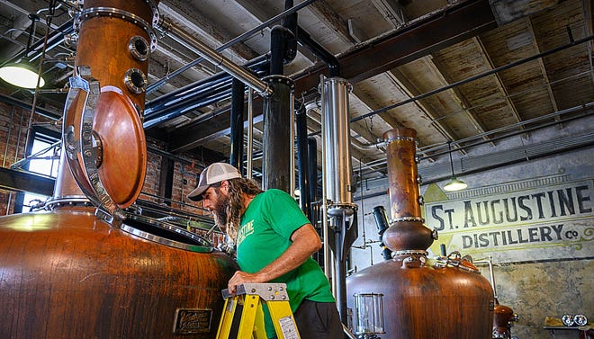 St. Augustine Distillery production manager Lucas Smith checks a still in the distillery in St. Augustine on  Aug. 21, 2020.