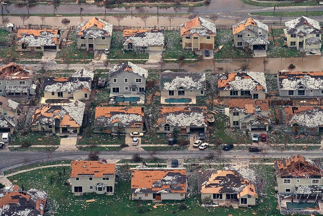 Rows of damaged houses between Homestead and Florida City are damaged by Hurricane Andrew on Aug. 25, 1992.