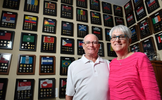 Bill and Gloria Weed display their love of travel with a collection of coins and flags from 118 countries they have visited. The pair contracted the coronavirus aboard the cruise ship Zaandam in March, along with another local traveler, Michael Richker, from Bradenton. All three have donated their convalescent plasma to those in need.